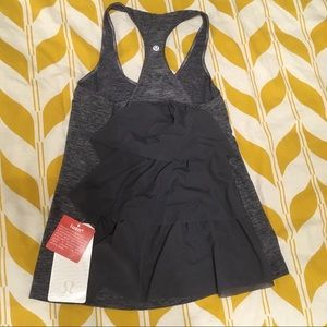 LuluLemon grey tank with tiered back veil flare